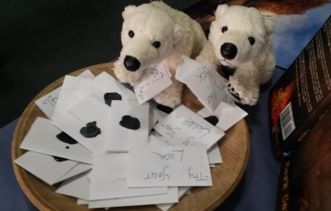 Two toy polar bears choosing lucky dip tickets at LonCon 2014