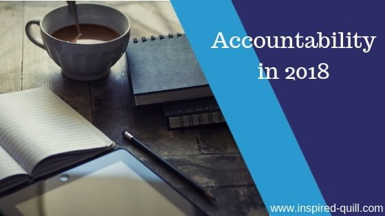 A blog feature image showing a cup of coffee next to notebooks and a pencil with the title 'Accountability in 2018' over the top