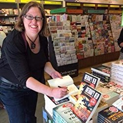 Author Jo Zebedee signing books at an event