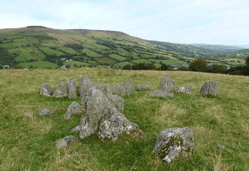 Ossian's Grave in Northern Ireland: large stones in a field with farms in the distance